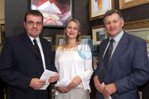Noel Curran, former producer of the Late Late Show, his wife Eimear Quinn, who represented Ireland in the Eurovision in Norway and Jim McArt, Reaghstown artist, pictured at the art exhibition at Aclint community hall which they officially opened. Picture: Arthur Carron/Newsfile